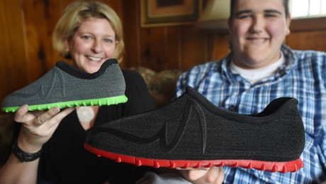 Broc Brown and his aunt Stacy Snyder compare their new Feetz shoes.