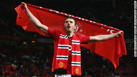 MANCHESTER, ENGLAND - APRIL 22: Michael Carrick of Manchester United celebrates victory and winning the Premier League title after the Barclays Premier League match between Manchester United and Aston Villa at Old Trafford on April 22, 2013 in Manchester, England.  (Photo by Alex Livesey/Getty Images)