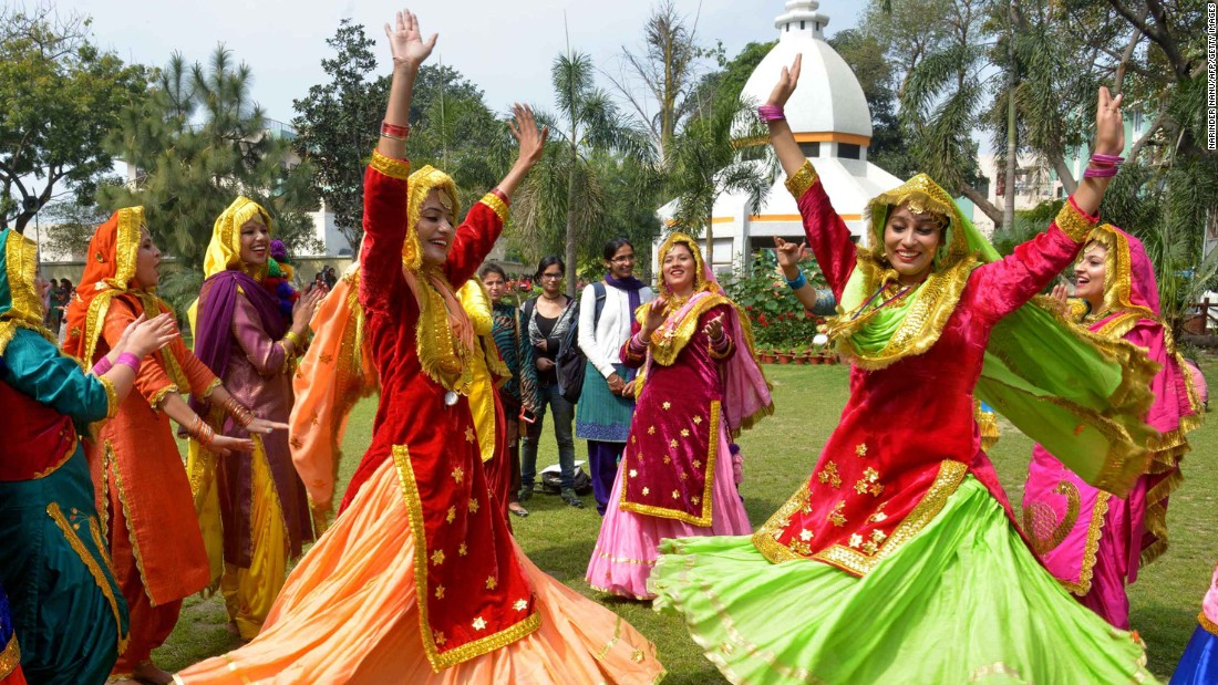 Women wear traditional Punjabi dresses as they dance during an event in Amritsar, India.