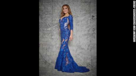 Camille Anderson, looking red carpet-ready in a slinky blue gown.