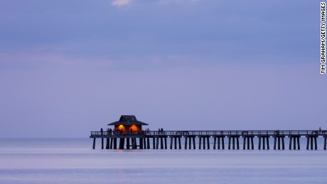 A moody sunset by the pier in the southwest Florida city of  Naples spells out contentment.