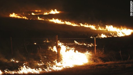 Wildfires swept by high winds burn near Protection, Kansas, on Tuesday.