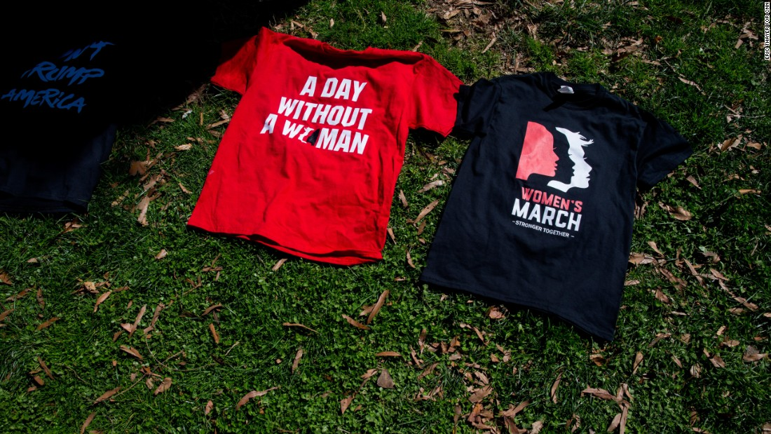 "Commemorative T-shirts are displayed in Washington. In the United States, women were encouraged to take the day off from paid and unpaid labor in a strike billed as ""A Day Without a Woman."""