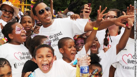 Ludacris with Venetian Hills Elementary students at a playground build in 2010.