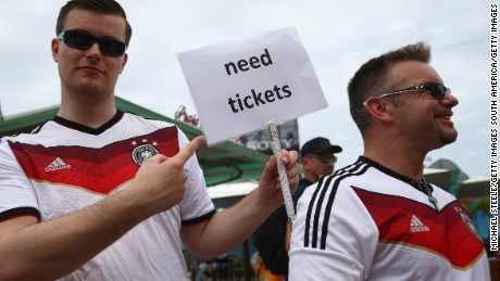 Germany fans seek match tickets ahead of the 2014 FIFA World Cup final.