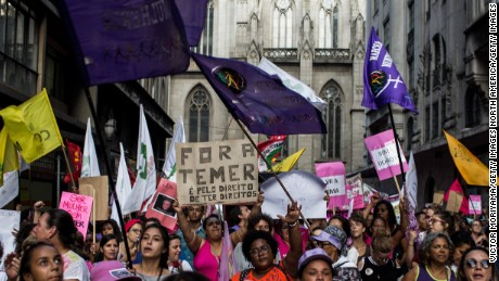 Several feminist groups protest against the Michel Temer government during a march on Women's Day on March 8, 2017 in Sao Paulo, Brazil.