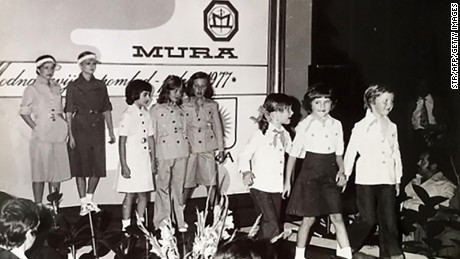 This picture provided by courtesy of Nena Bedek and taken in 1977 in Radenci, northeastern Slovenia, shows Slovenian-American former model and Donald Trump's wife Melania Trump (born Melanija Knavs)(2nd R) as a child, together with Nena Bedek (R), attending a fashion review of Jutranjka, the textile company where her mother used to work.