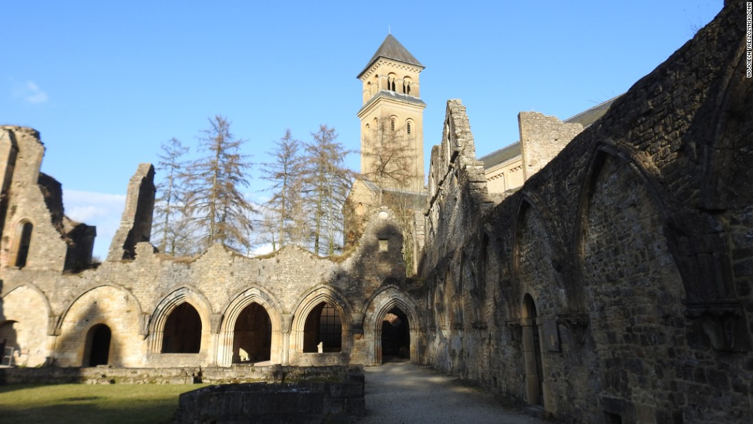 The cloisters of the old abbey can still be seen today. The newer 20th-century reconstruction towers above.