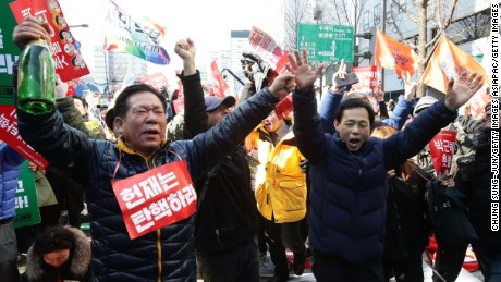 South Koreans celebrate after hearing the Constitutional Court's verdict.