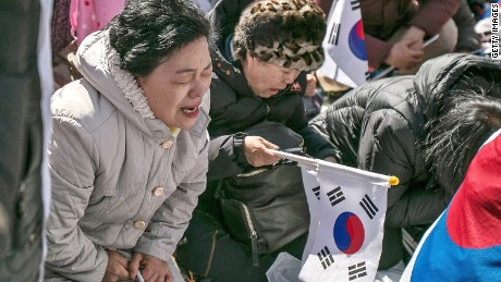 SEOUL, SOUTH KOREA - MARCH 10:  Supporters of President Park Geun-hye react emotionally as the Constitutional Court had ruled the impeachment near the court on March 10, 2017 in Seoul, South Korea. Park will be permanently removed from the South Korean office and the nation will need to hold a presidential election within 60 days. Park had been impeached by parliament in December for allegedly letting her confidante Choi Soon-sil involved in state affairs and colluded to take bribes of millions of dollars from South Korean conglomerates.  (Photo by Jean Chung/Getty Images)