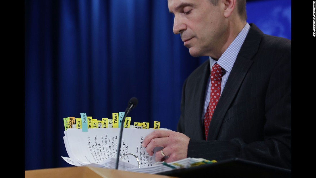 "Mark Toner, acting spokesman of the US State Department, thumbs through notes during a press briefing in Washington on Tuesday, March 7. It was the State Department's <a href=""http://www.cnn.com/2017/03/07/politics/state-department-briefings-resume/"" target=""_blank"">first press briefing since President Trump took office.</a> The news conference lasted just over an hour and included pointed questions on North Korea's recent missile launch, the administration's updated travel ban and Secretary Rex Tillerson's upcoming travel to Asia."