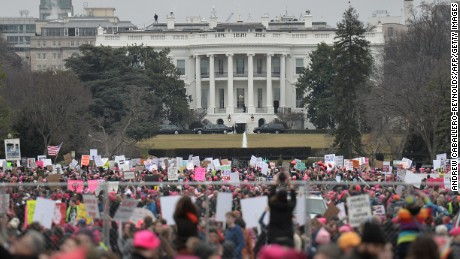 TOPSHOT - Demonstrators protest  near the White House in Washington, DC, for the Women's March on January 21, 2017.