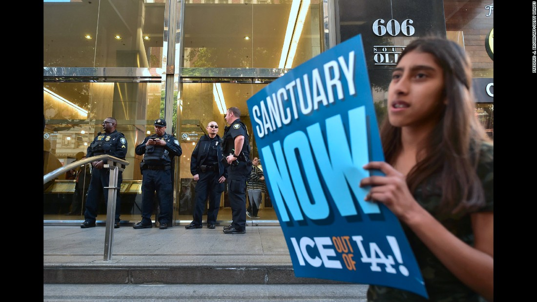"Protesters gather outside the Los Angeles Immigration Court building after a rally on Monday, March 6. The rally was held a few days after <a href=""http://www.cnn.com/2017/03/03/us/california-father-ice-arrest-trnd/"" target=""_blank"">the arrest of Romulo Avelica-Gonzalez,</a> an undocumented immigrant who was detained by immigration agents as he drove his teenage daughter to school. Immigration and Customs Enforcement said in a statement that he was arrested because he has ""multiple prior criminal convictions, including a DUI in 2009, as well an outstanding order of removal dating back to 2014."" Since President Trump's inauguration, scores of unauthorized immigrants have been detained and deported under his administration's hard-line immigration stand."