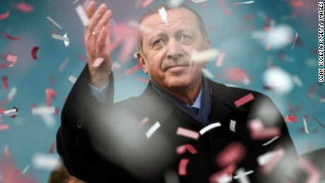 Turkish President Recep Tayyip Erdogan gestures amid confetti during a rally in Istanbul on March 11, 2017. Erdogan threatened to retaliate after the Netherlands banned the foreign minister from flying in for a campaign rally, as he said The Hague's behavior was reminiscent of Nazism.