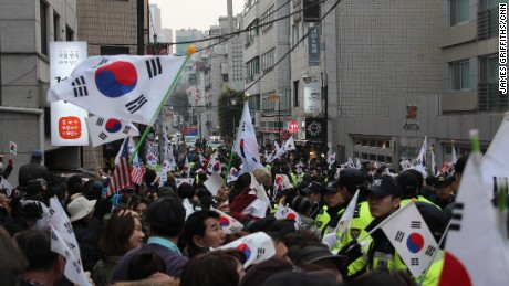Supporters of impeached South Korean President Park Geun-hye gather outside her house Sunday in Seoul's Gangnam district.