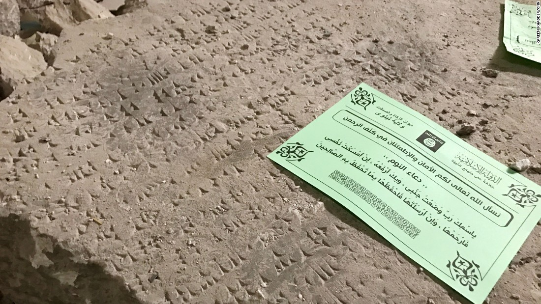 An ISIS leaflet left on an artifact's remains. The leaflet is a prayer for sleep.