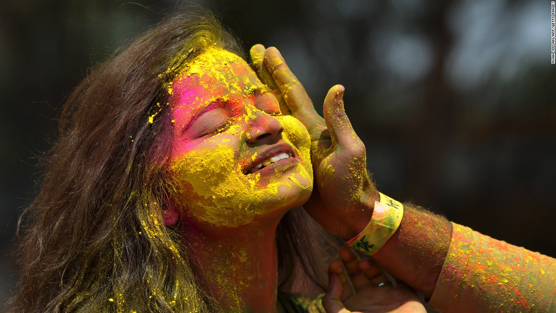 Revelers play with colors during a Holi celebration in Hyderabad, India, on Monday, March 13.