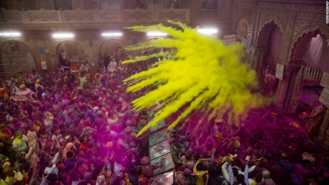 Hindu devotees throw colored powder on one another inside a temple in Vrindavan, India, on Wednesday, March 8.