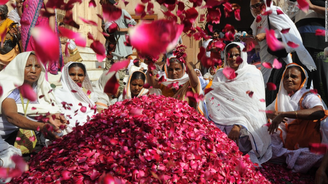 Indian widows celebrate Holi in Vrindavan on Thursday, March 9.