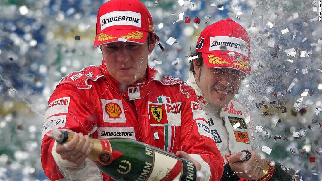 Raikkonen (left) and Spain's Fernando Alonso spray champagne on the podium at the 2007 Brazilian Grand Prix where the Finn clinched his maiden world crown.