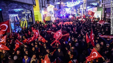 Protestors wave Turkish flags outside the Dutch consulate in Istanbul, March 11.