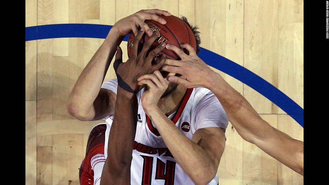 Louisville forward Anas Mahmoud has his shot blocked during an ACC Tournament game against Duke on Thursday, March 9.