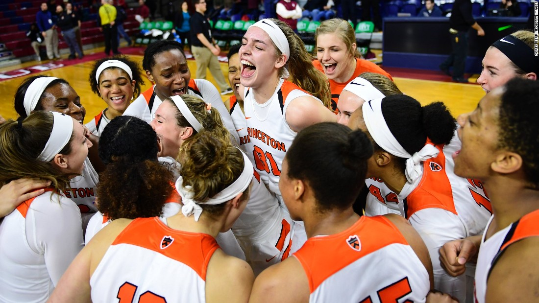 Princeton's basketball team celebrates after winning its Ivy League semifinal against Harvard on Saturday, March 11.
