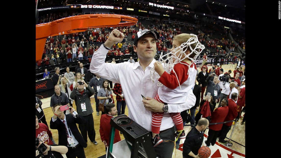 Iowa State head coach Steve Prohm holds his 2-year-old son, Cass, while cutting down the nets at the Big 12 Tournament on Saturday, March 11. Iowa State defeated West Virginia 80-74 in the final.