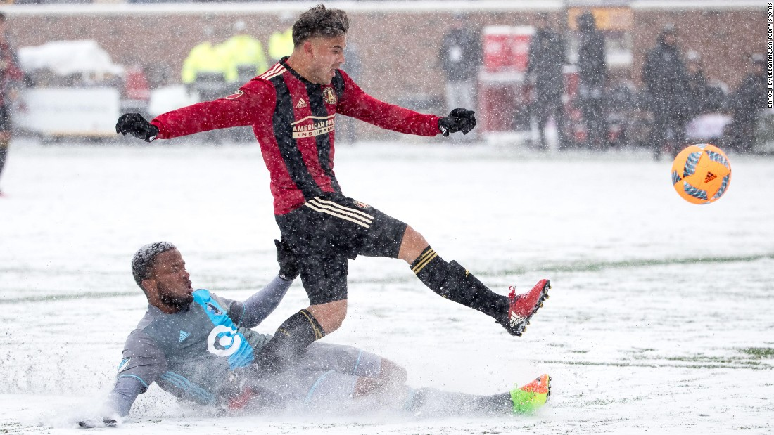 Atlanta United's Hector Villalba is tackled by Minnesota United's Jermaine Taylor during a Major League Soccer match Sunday, March 12. Atlanta won 6-1, ruining Minnesota's first home match since joining MLS. It was 20 degrees at kickoff, tying the coldest match in league history.<br />