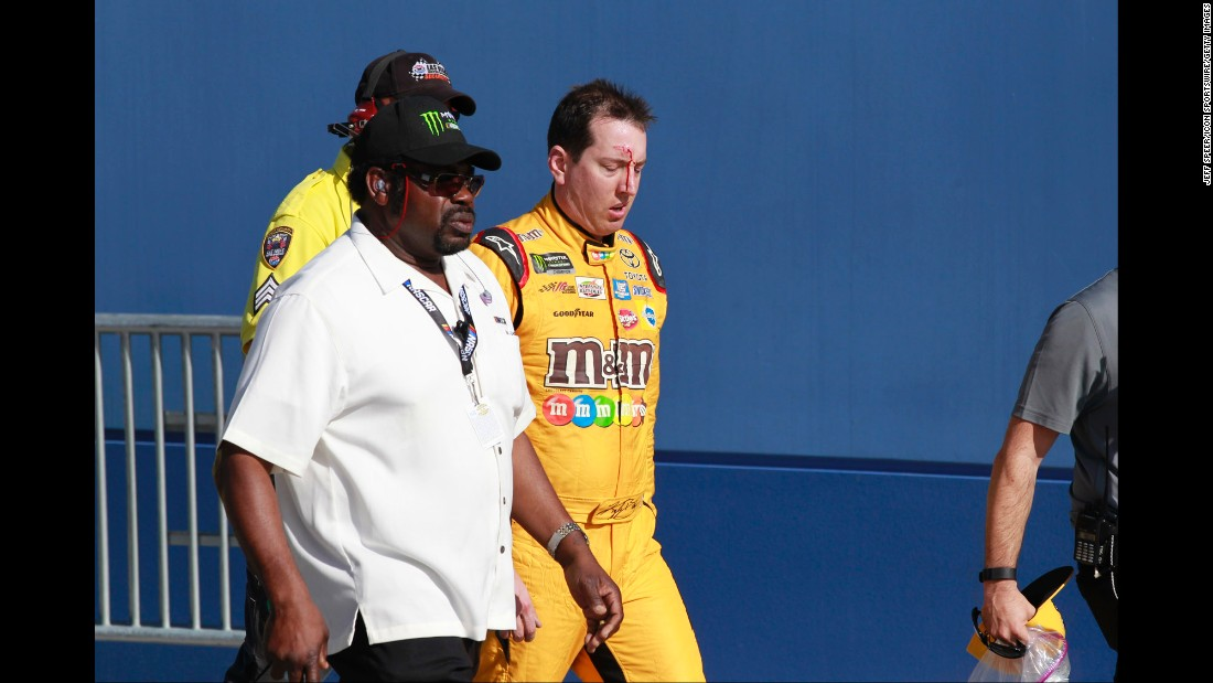 NASCAR driver Kyle Busch bleeds from the forehead after getting in a post-race scrum with Joey Logano and Logano's crew on Sunday, March 12. Busch attacked Logano following the Cup Series race at Las Vegas Motor Speedway. He was upset with being spun out during the race. <br />
