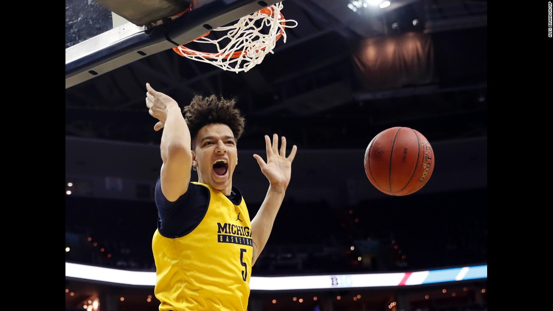 "Michigan forward D.J. Wilson dunks the ball during a Big Ten tournament game against Illinois on Thursday, March 9. The Wolverines had to play in their practice jerseys because <a href=""http://www.freep.com/story/news/local/michigan/2017/03/08/university-michigan-basketball-plane-crash/98914844/"" target=""_blank"">of a plane crash</a> one day earlier. No one was hurt when the team plane skidded off the runway after an aborted takeoff, but the uniforms had to be left on the plane while authorities investigated the scene. Michigan went on to win four games in four days, defeating Wisconsin in the tournament final.<br />"