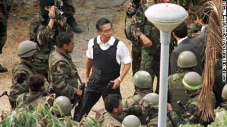 TO GO WITH AFP STORY File picture taken April 1997 of former president Alberto Fujimori (C) leading a group of special forces troops inside the Japanese ambassador's residence in Lima after releasing the 77 hostages captured by theRevolutionary Movement Tupac Amaru (MRTA) guerrilla group. Next 10 December 2007 Fujimori will face the first of seven trials that will be carried out for charges of corruption and the killing of 25 people by death squads during his rule. AFP PHOTO/MARIE HIPPENMEYER (Photo credit should read MARIE HIPPENMEYER/AFP/Getty Images)