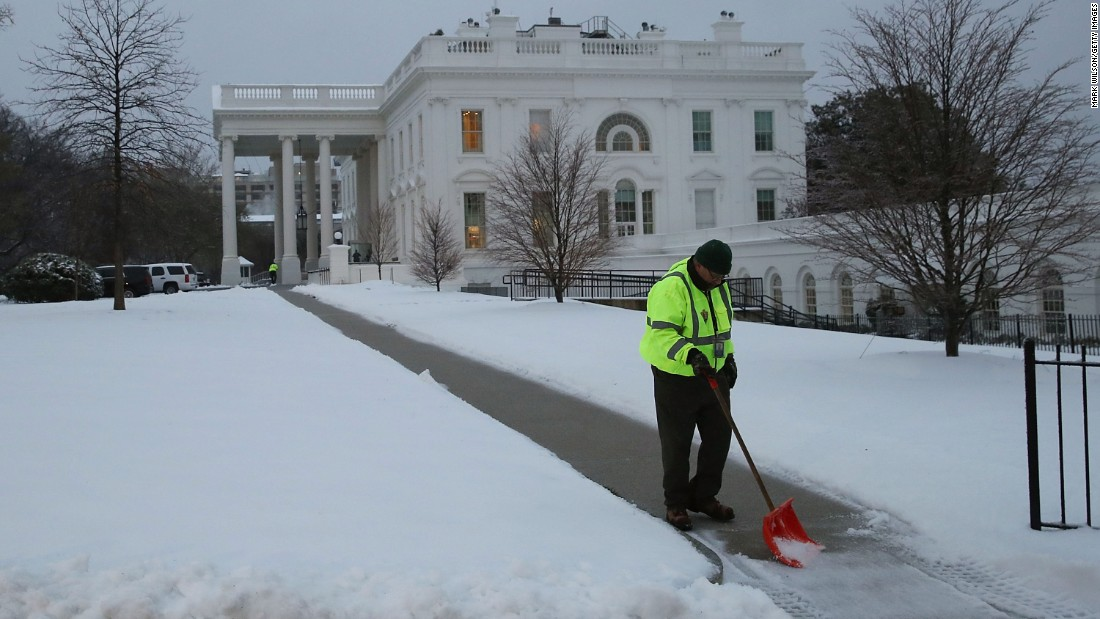 A National Park Service employee shovels snow at the White House on March 14.