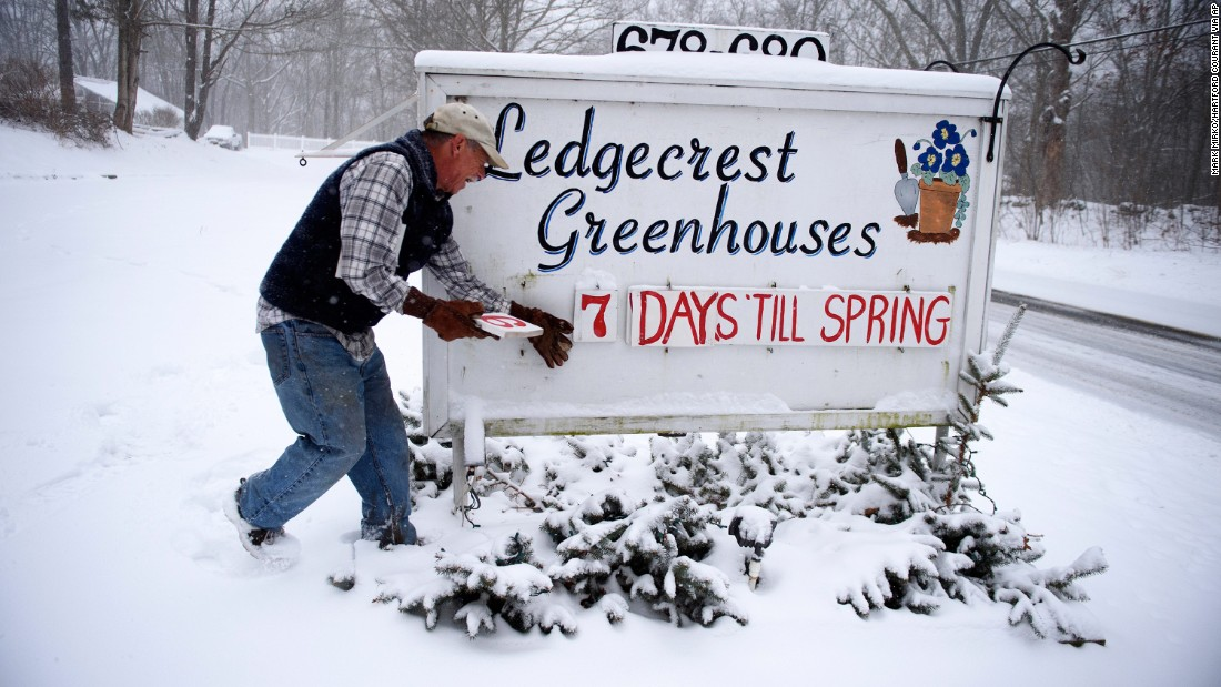 Paul Hammer updates the sign in front of his nursery in Mansfield, Connecticut, on Tuesday, March 14.