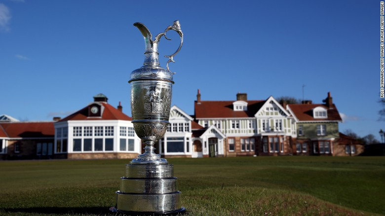 The Claret Jug trophy beside the 18th green in front of Muirfield's clubhouse