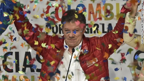 Colombian President and presidential candidate Juan Manuel Santos celebrates after knowing the results of the presidential election on May 25, 2014 in Bogota. Santos and former conservative ally Oscar Zuluaga are heading to a second round on June 15 after neither claimed a majority in Sunday's presidential election. AFP PHOTO / Luis Acosta        (Photo credit should read LUIS ACOSTA/AFP/Getty Images)