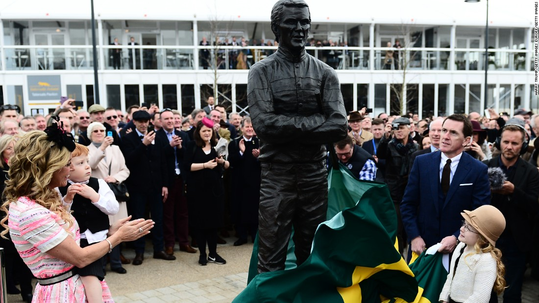Legendary jockey A.P. McCoy, who has ridden 31 winners and won two Gold Cups at the Festival, unveils a statue of himself at the racecourse this year.