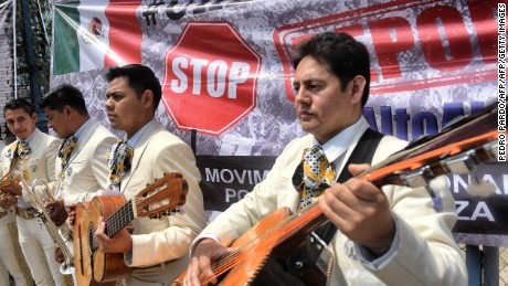 "Mexican mariachis play the US national anthem while civil organizations carry out a demonstration called ""Serenade to Break the Wall"" against US President Donald Trump's immigration policies, in front of the US embassy in Mexico City, on March 14, 2017. / AFP PHOTO / Pedro PARDO        (Photo credit should read PEDRO PARDO/AFP/Getty Images)"