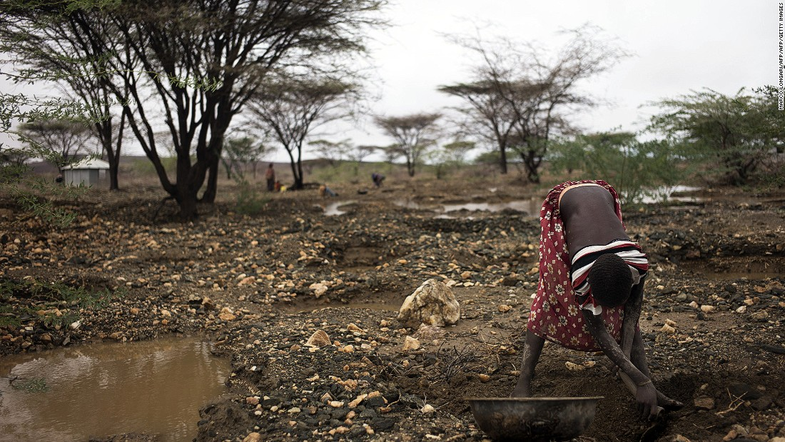 A member of the Turkana community of Lolupe, north of Lodwar in the Turkana region, searches for gold specks. A first downpour relieved pastoralists in the drought stricken Kenyan Turakana region after a twelve month span that pushed livestocks and communities to the brink of another looming humanitarian crisis.