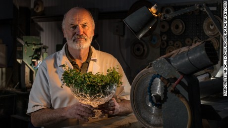 Craftsman Eamonn Terry working on a crystal shamrock bowl in Waterford, Ireland, that Irish leader Enda Kenny will give President Doanld Trump at the White House's annual St Patrick's Day celebration on Thursday.