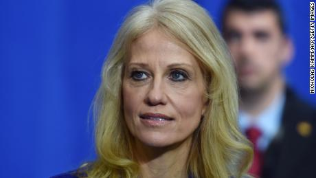 Counselor to the President Kellyanne Conway, listens as US President Donald Trump speaks at American Center for Mobility in Ypsilanti, Michigan on March 15, 2017.