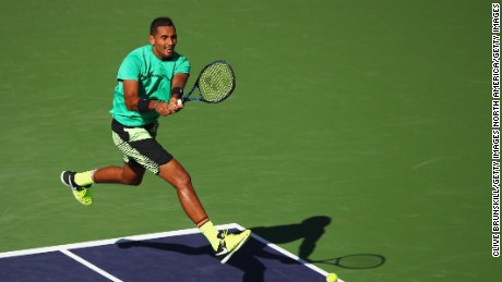 Nick Kyrgios plays a backhand during his fourth-round win over Novak Djokovic at Indian Wells.
