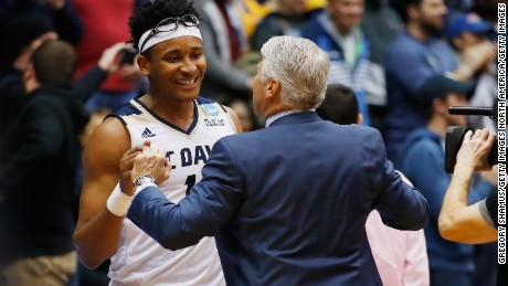 Moneke reacts with head coach Jim Les after defeating North Carolina Central.