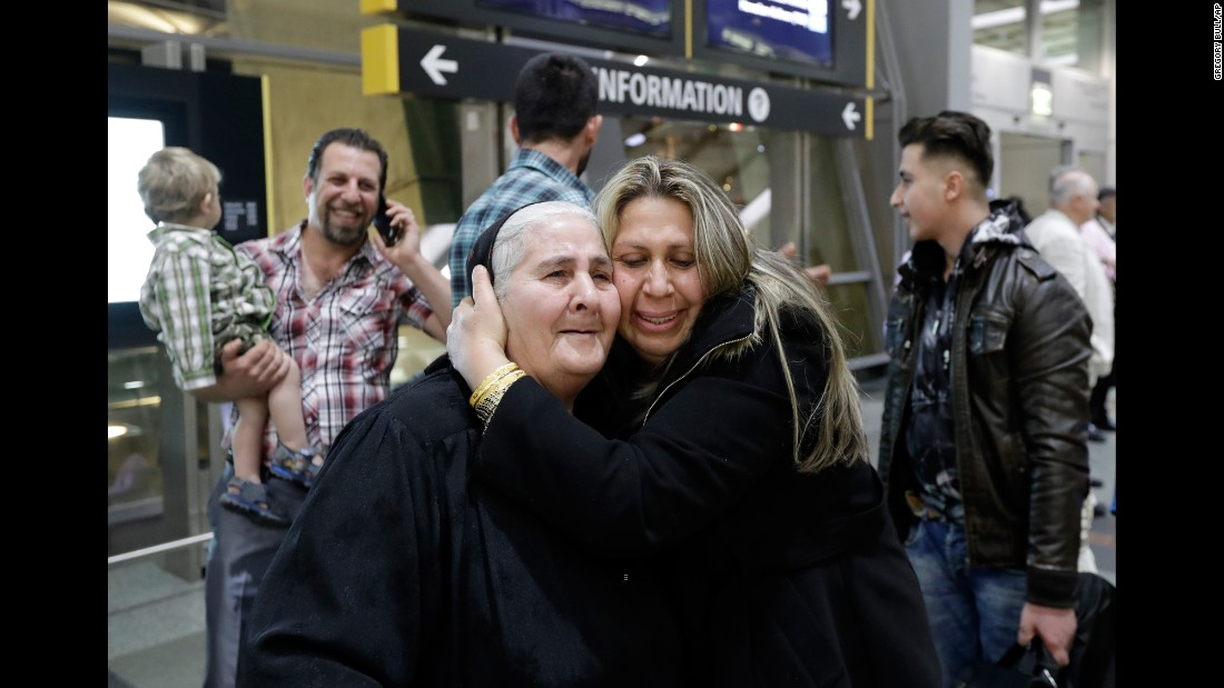 Nadia Hanan Madalo hugs her mother, Alyshooa Kannah, at an airport in San Diego on Wednesday, March 15. Madalo and her family are Iraqi refugees who were forced to flee the town of Batnaya after ISIS militants invaded several years ago.