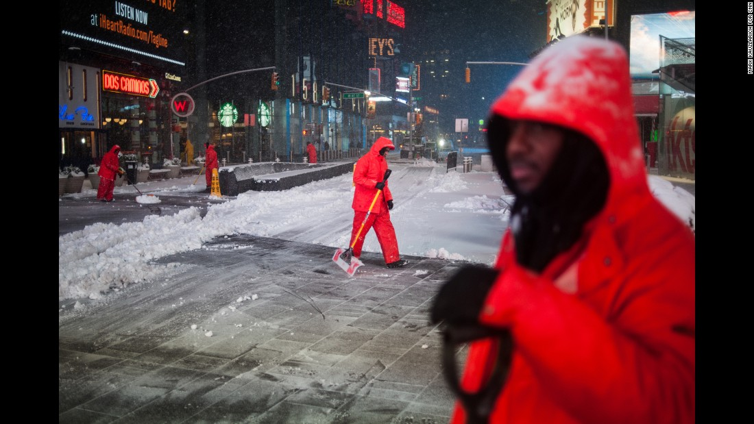 "Workers clear snow in New York's Times Square on Tuesday, March 14. The city was spared the worst of <a href=""http://www.cnn.com/2017/03/14/weather/gallery/northeast-winter-weather-0314/index.html"" target=""_blank"">this week's nor'easter,</a> but it still got plenty of wet and heavy snow. <a href=""http://www.cnn.com/2017/03/14/us/new-york-winter-storm-before-after-sliders/index.html"" target=""_blank"">See New York before and after the storm</a>"