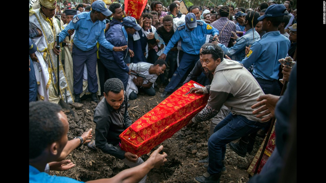 "A coffin is buried outside a church in Addis Ababa, Ethiopia, on Monday, March 13. More than 100 people were killed after <a href=""http://www.cnn.com/2017/03/15/africa/ethiopia-trash-landslide-death-toll/"" target=""_blank"">a weekend landslide</a> at a massive landfill."