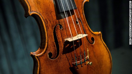 A rare 1684 violin by Antonio Stradivari is displayed during a media preview at Sotheby's in Hong Kong on February 21, 2017, ahead of the violin's auction on March 28 in London where it is estimated to fetch 1.55 to 2.45 million USD. / AFP / ISAAC LAWRENCE        (Photo credit should read ISAAC LAWRENCE/AFP/Getty Images)