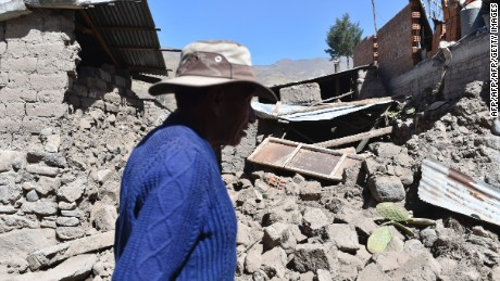 A man walks by toppled houses on August 15, 2016 in the Andean town of Yanque in southern Peru, after a 5.3 magnitude earthquake struck this remote picturesque region in the state of Arequipa on Sunday night. At least four other people also died and 68 were injured, most by toppling buildings. Rescue and aid efforts have been hampered by more than 60 replica aftershocks that have rocked the area, which is popular with tourists, in the past 24 hours.  / AFP / Jose Sotomayor Jimenez        (Photo credit should read JOSE SOTOMAYOR JIMENEZ/AFP/Getty Images)