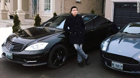 Karim Baratov with two of his cars at his home in Ancaster, Ontario, Canada.