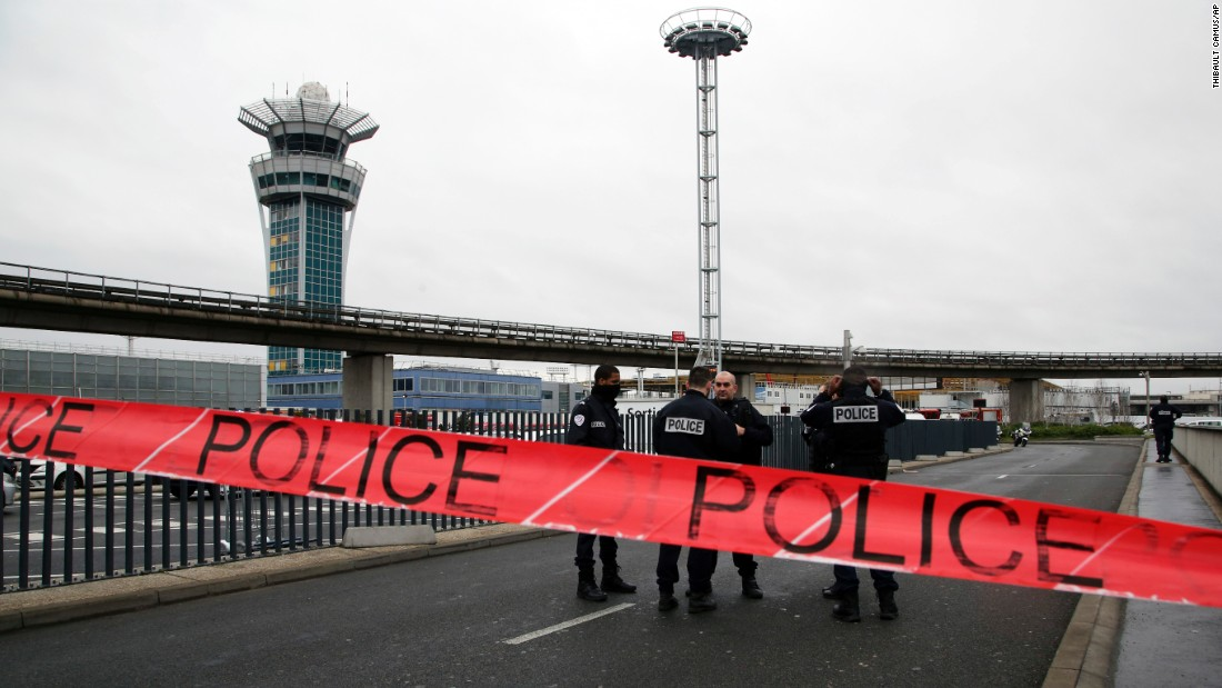 Police cordon off access to Paris Orly Airport after a man was shot and killed on Saturday, March, 18, after he tried to seize a soldier's weapon.